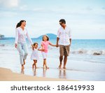 happy young family walking on... | Shutterstock . vector #186419933
