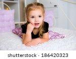 cute little kid in dress on the ... | Shutterstock . vector #186420323