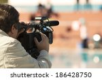 cameraman over blurry background | Shutterstock . vector #186428750