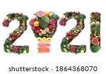 Small photo of 2021 made of fruits and vegetables including a light bulb icon