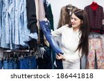 young girl choosing jeans at