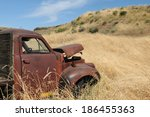 Abandoned Rusty Truck Against...