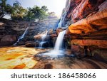 Waterfall And Mountain...