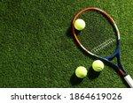 Tennis Racket And Balls On...