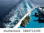 Ocean trail waves of a cruise ship. Traveling and cargo shipping concept image.