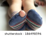 Stock photo worn out socks worn socks with a hole and a finger sticking out of them 186498596