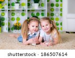 happy girls drinking milk at... | Shutterstock . vector #186507614