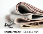A Stack Of Newspapers With...