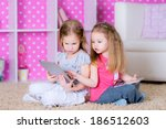 sisters  using modern tablet...   Shutterstock . vector #186512603