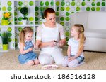 mother and little sisters... | Shutterstock . vector #186516128