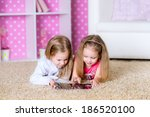 happy kids using tablet computer   Shutterstock . vector #186520100