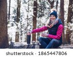 A Smiling Female Tourist Takes...