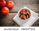sun dried and fresh tomatoes | Shutterstock . vector #186547310