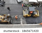 Small photo of ROME DICEMBER 01 2020 MEN AT WORK TO REDO THE ASPHALT OF A ROAD