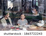 A Young Family Having A Luch...