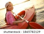 Happy Girl Kayaking On River At ...