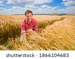 Close Up Of A Farmer Sitting...