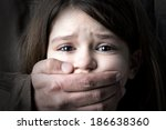 scared young girl with an adult ... | Shutterstock . vector #186638360