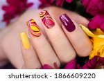 Small photo of Nail design on shiny and matte nail Polish with smooth curves.Fashionable multicolored manicure.