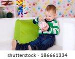 beautiful boy in her room   Shutterstock . vector #186661334