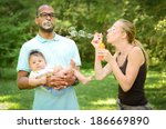 happy interracial family is... | Shutterstock . vector #186669890
