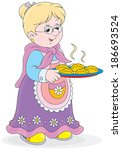 grandmother holding a tray of... | Shutterstock .eps vector #186693524