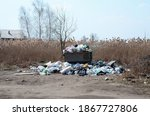 Small photo of The garbage can is packed with garbage and waste. Untimely removal of garbage in populated areas