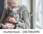 Elderly woman in protective...