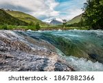 Norwegian landscape with cold mountain river - stock photo