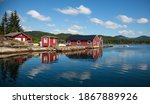 Norwegian Boathouses Over A Bay ...