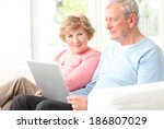 happy senior couple sitting at... | Shutterstock . vector #186807029
