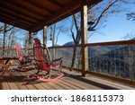 Red Rockers On Porch...