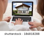 couple looking at house on... | Shutterstock . vector #186818288