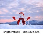 Snowman In Santa Hat And Red...