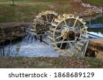 An Old Waterwheel In The Park