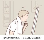 young man looking at mirror at... | Shutterstock .eps vector #1868792386