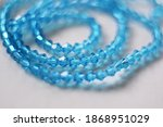 Blue Bicone Beads On White...