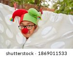 Child Disguised As A Jolly...