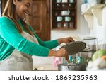 Latin Mature Woman Cooking In...