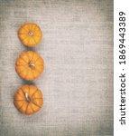 Mini Pumpkins On Side Of Tan...