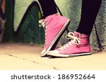 close up of pink sneakers worn... | Shutterstock . vector #186952664