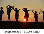 happy children silhouettes on... | Shutterstock . vector #186957380