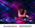 attractive young dj playing on... | Shutterstock . vector #186960650