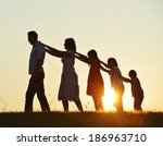happy family silhouettes on... | Shutterstock . vector #186963710