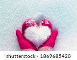 Hands In Knitted Mittens With A ...
