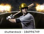 baseball player on a yellow... | Shutterstock . vector #186996749