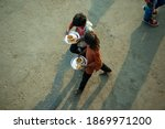 Small photo of Ghaziabad, Uttar Pradesh, India- December 8 2020: Local dweller children carrying food from langar (community kitchen) during farmer's protest.