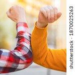 Small photo of Don't shake hands. Stop handshakes. Coronavirus epidemic. Coronavirus, illness, infection, quarantine, COVID-19. Elbow bump. Bump elbows. Friends shaking elbows outdoors. Elbow greeting style.