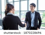 Small photo of Asian businesswoman and businessman shaking hands at In the office room background after the contract is signed or handshake greeting deal,business expressed confidence embolden and successful couple