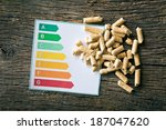 the wooden pellets and energy efficiency levels - stock photo